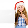 Santa women pointing at the white board — Stock Photo #3440737