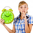Stockfoto: Girl with clock asking us to maintain silence