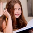 Closeup of cute little girl doing her homework — 图库照片