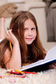 Closeup of cute little girl doing her homework — Stok fotoğraf