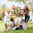 Family holding back grandfather and having fun — Stock Photo