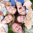 Multi-generation family lying in circle — Stock Photo #3521196