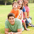 Portrait of happy family looking at camera — Stock Photo