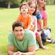 Portrait of happy family looking at camera — Stock Photo #3605806