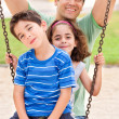 Kids having fun with their father — Stock Photo