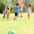 Family spending their leisure time in the park — Foto de stock #3605966