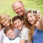 Family outdoors taking self portrait — Stock Photo
