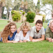 Stock Photo: Affectionate family lying in the park
