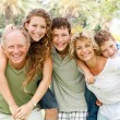 Garandparents giving piggyback ride — Stock Photo #3606039