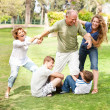 Family holding back grandfather — Stock Photo #3606042