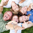 Happy family lying as a circle — Stock Photo #3606047