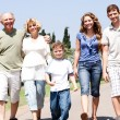 Extended family group walking down the pathway — Stock Photo