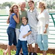 Family posing infront of lake — Stock Photo #3606083