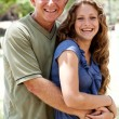Aged father embracing her daughter - Foto Stock