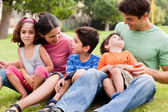 Happy family enjoying summer day in the park — Stock Photo