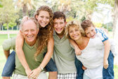 Garandparents giving piggyback ride — Stock Photo