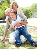 Grandparents playing with grandson — Stock Photo