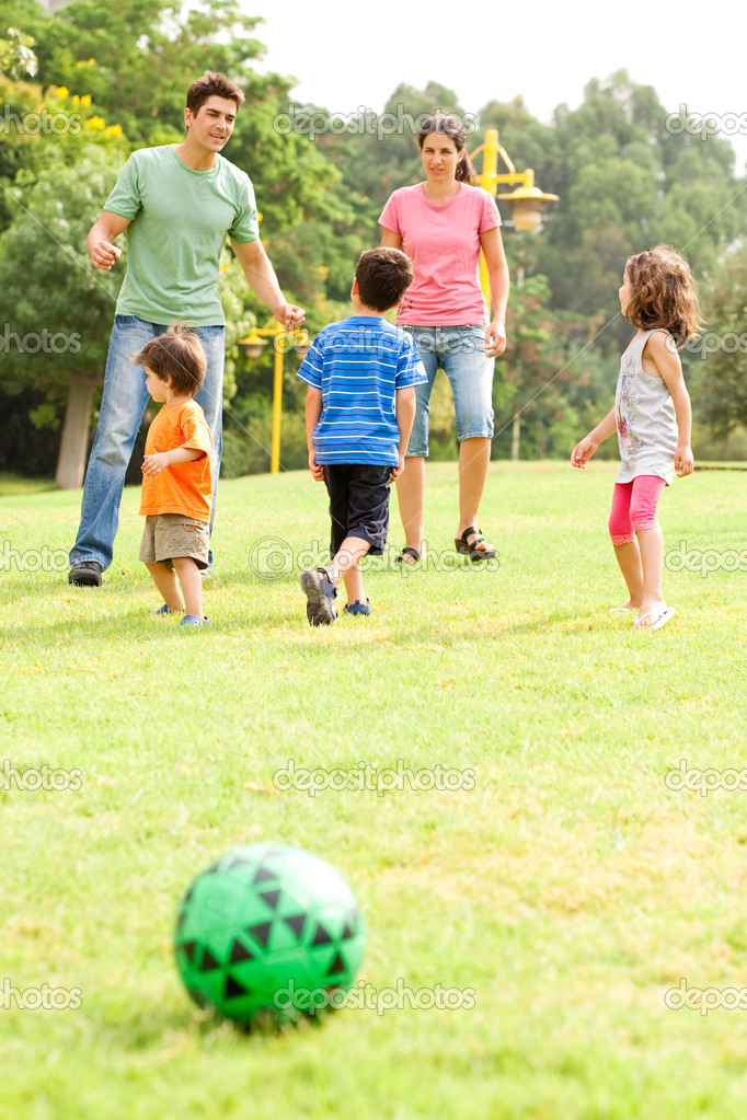 Family enjoying football on a sunny afternoon — Stock Photo #3605966