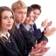 Colleagues applauding during a business meeting - Stock Photo