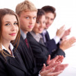 Colleagues applauding during a business meeting - Foto Stock