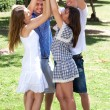 Group of happy friends with raised arms — Stockfoto