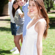 Royalty-Free Stock Photo: Four teens hang out in a park