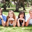Stock Photo: Four teens with hands on their chin