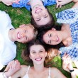 Young friends forming a circle - Foto Stock