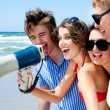 Teenagers shouting through megaphone — Stockfoto
