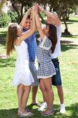 Grupo de amigos felices con los brazos levantados — Foto de Stock
