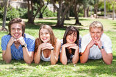 Four teens with hands on their chin — Stock Photo
