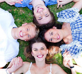 Young friends forming a circle — Stock Photo