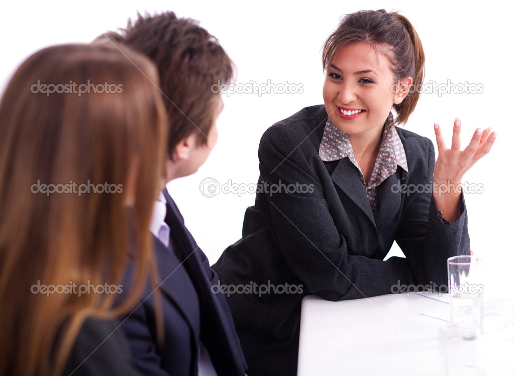 Smiling businesswoman having healthy discussion with fellow mates  Stock Photo #3676763