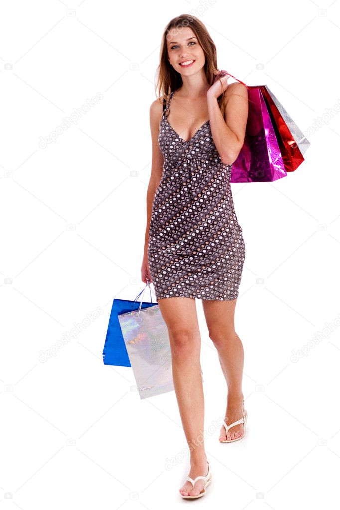 Beautiful young girl carrying shoping bags in her hand isolated against white background — Stock Photo #3676840