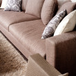 Contemporary sofa in modern setting — Stock Photo