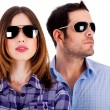 Stylish couple wearing sunglasses — Stok fotoğraf
