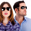 Stylish couple wearing sunglasses — Stock fotografie