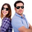Stylish couple posing back to back — Stockfoto