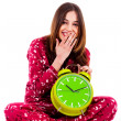 Teenager sitting with alarm clock — Stock Photo