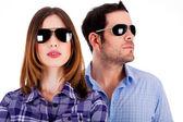 Stylish couple wearing sunglasses — Stock Photo