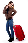 Young lady posing with luggage — Stock Photo