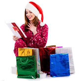 Young lady with christmas card and gifts — Stock Photo
