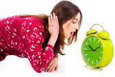 Lady looking at alarm clock — Stock Photo