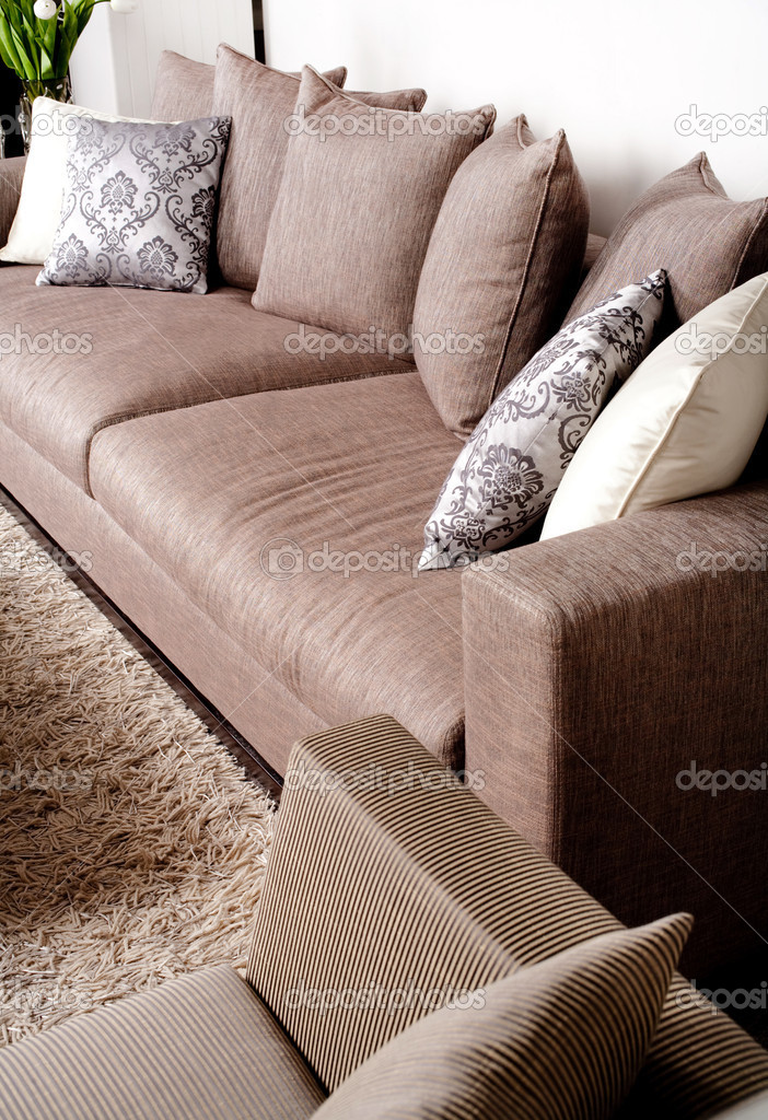 Contemporary sofa in modern setting with many pillows — Stock Photo #3710239