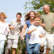 Happy family in playful mood — Stock Photo