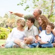 Potrait of grandfather pointing with family — Stock Photo
