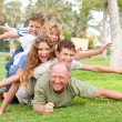 Happy family laying on each other — Stock Photo