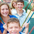 Image of Portrait of a happy family swinging in a line — Stock Photo #3731931