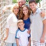 Portrait of family on hanging bridge — Stock Photo