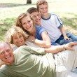 Family laying in line — Stock Photo #3731933